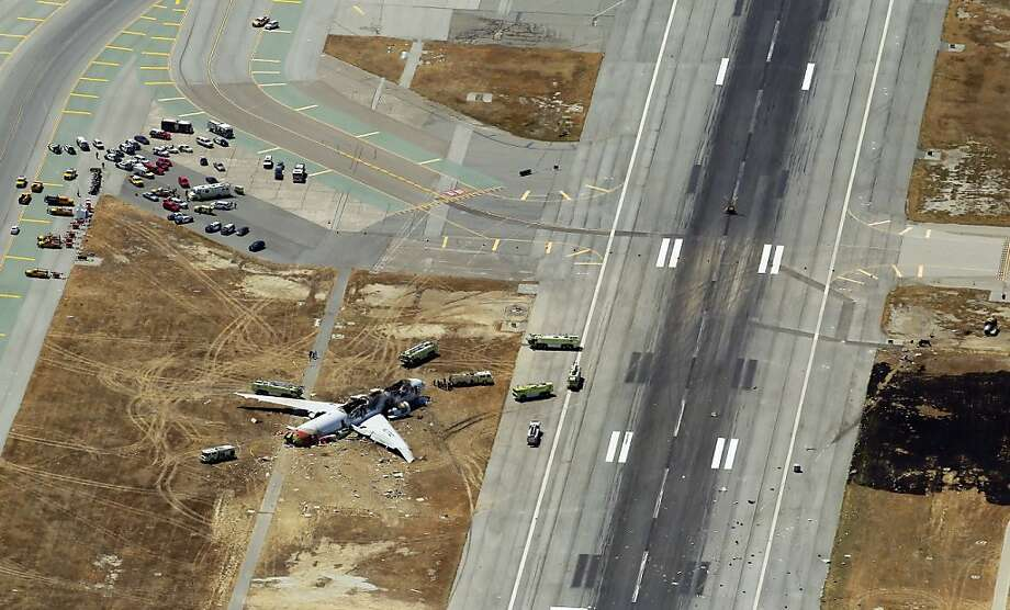 Emergency vehicles encircle the Asiana aircraft that crashed while trying to land at San Francisco International Airport in July. Photo: Carlos Avila Gonzalez, The Chronicle