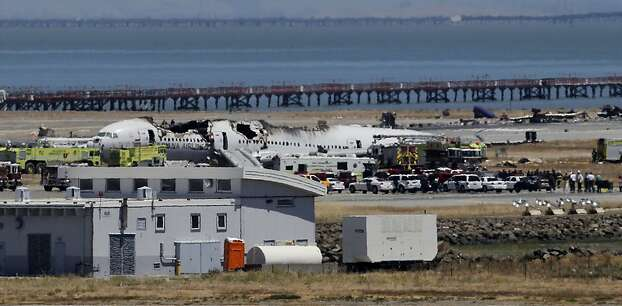 The wreckage of Asiana flight 214 sits beside the runway in San Francisco, Calif., on Saturday July 6, 2013, following a crash landing this morning at San Francisco International airport. Photo: Michael Macor, The Chronicle