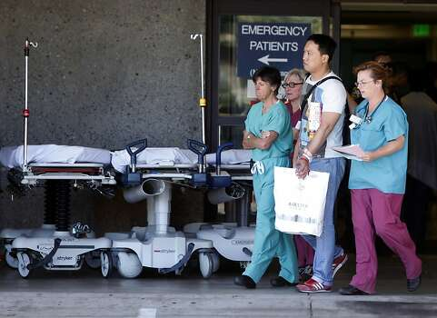 Passengers aboard the Asiana Airlines flight that crashed at San Francisco International Airport arrive at San Francisco General Hospital on Saturday, July 6, 2013 in San Francisco, Calif. Photo: Russell Yip, The Chronicle