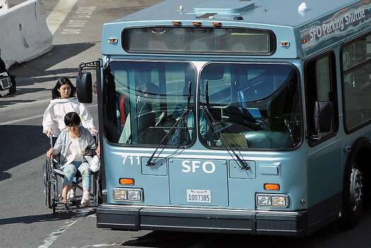 Victims of the Asiana plane crash are loaded onto waiting buses at the North Wing of the International Terminal at SFO in San Francisco, CA Saturday, July 6th, 2013. Photo: Michael Short, Special To The Chronicle