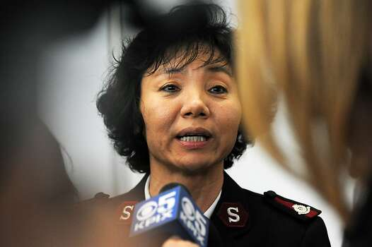 Okkyong Kim, a Corps. Officer for the Sunnyvale Grace Cathedral Church, speaks with the media outside the Reflection Room where potential victims of the Asiana plane crash and their families are being held in the North Wing of the International Terminal at SFO in San Francisco, CA Saturday, July 6th, 2013. Photo: Michael Short, Special To The Chronicle