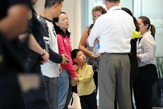 Potential family of victims of the Asiana plane crash are breifed outside the Reflection Room in the North Wing of the International Terminal at SFO in San Francisco, CA Saturday, July 6th, 2013. Photo: Michael Short, Special To The Chronicle