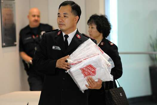 A Salvation Army worker carries blankets into the Reflection Room, where family and friends of Asiana crash victime are being held, in the International Terminal at SFO in San Francisco, CA Saturday, July 6th, 2013. Photo: Michael Short, Special To The Chronicle