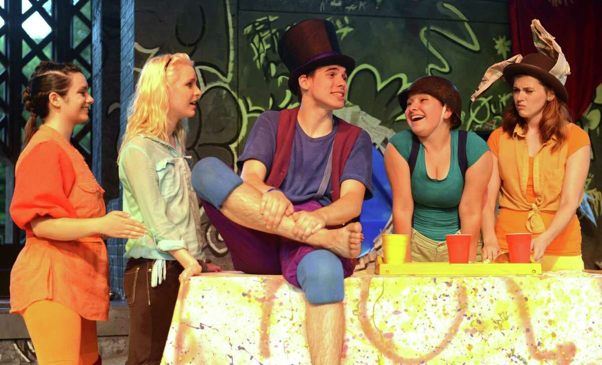 """From left, Katrina Sebastian, Kera Lalli playing Alice, Jim Goggin playing the Mad Hatter, Frankie Marcille, and Nicole Curriel act out a scene during Western Connecticut State University's presentation of """"Alice in Wonderland"""" at Ives Concert Park in Danbury, Conn. on Saturday, July 6, 2013. The show was the first of a double feature, coupled with the monologue """"War Stars: An Unauthorized Parody,"""" and kicked off the Ives Concert Park Fine Arts and Family Series."""