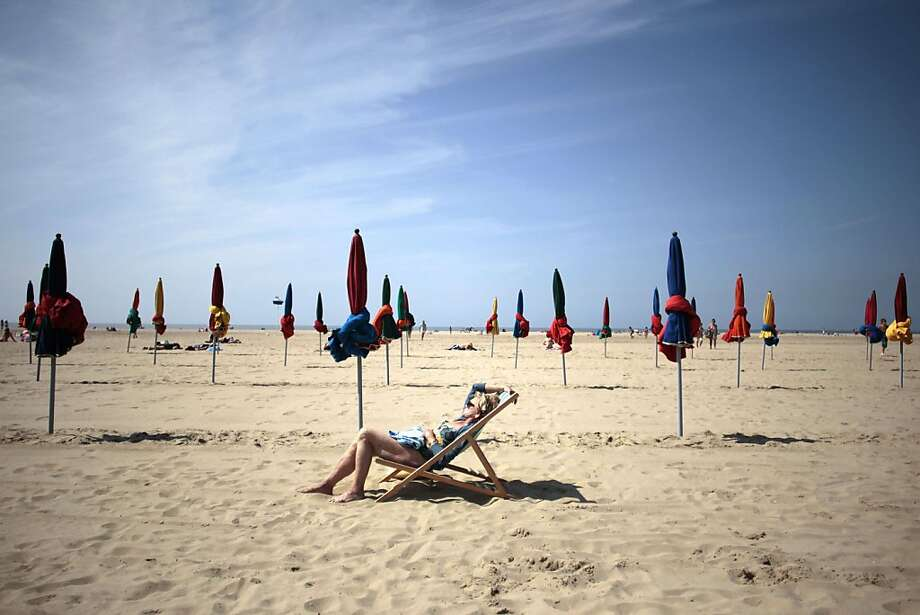 A woman takes a sunbath on July 5, 2013 on the beach ofn the northwestern city of Deauville. AFP PHOTO CHARLY TRIBALLEAU.CHARLY TRIBALLEAU/AFP/Getty Images Photo: Charly Triballeau, AFP/Getty Images