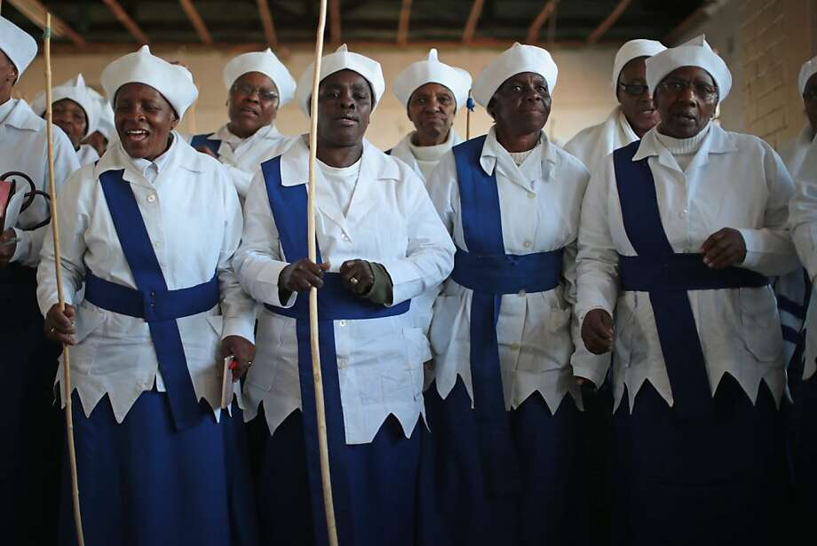 JOHANNESBURG, SOUTH AFRICA - JULY 06:  The ladies section of the Gauteng Christian Catholic Apostolic Church In Zion take part in a service which incorporated prayers and singing for ailing Nelson Mandela on July 6, 2013 in  Soweto Township, Johannesburg, South Africa. Mandela has been hospitalized at the Medi-Clinic Hospital since June 8 in treatment for a recurring lung infection.  (Photo by Christopher Furlong/Getty Images)  Photo: Christopher Furlong, Getty Images