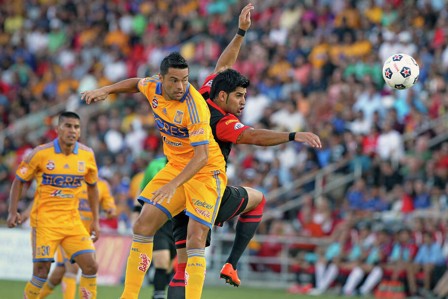 Esteban Bayona tries a shot on goal against  Anselmo Juninho as the Scorpions host the UNAL Tigres at Toyota Field on July 6, 2013. Photo: Tom Reel, San Antonio Express-News