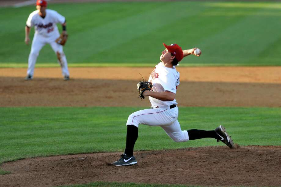 ValleyCats Andrew Thurman, right, winds up a pitch during their baseball game against Lowell Spinners on Saturday, June 6, 2013, at Bruno Stadium in Troy, N.Y. (Cindy Schultz / Times Union) Photo: Cindy Schultz / 00023061A