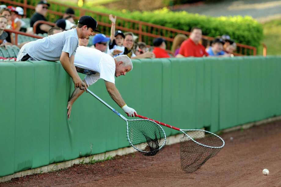 ValleyCats fans use fishing nets as they try to retrieve a foul ball during their baseball game against  Lowell Spinners on Saturday, June 6, 2013, at Bruno Stadium in Troy, N.Y. (Cindy Schultz / Times Union) Photo: Cindy Schultz / 00023061A