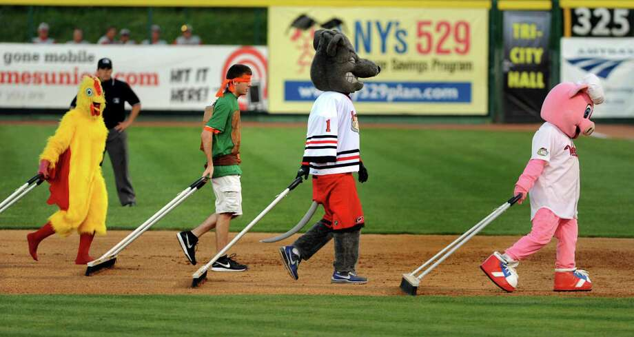 An assortment of characters drag the infield line during the ValleyCats vs. Lowell Spinners baseball game on Saturday, June 6, 2013, at Bruno Stadium in Troy, N.Y. (Cindy Schultz / Times Union) Photo: Cindy Schultz / 00023061A
