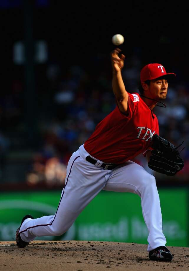 Yu Darvish throws against the Astros.