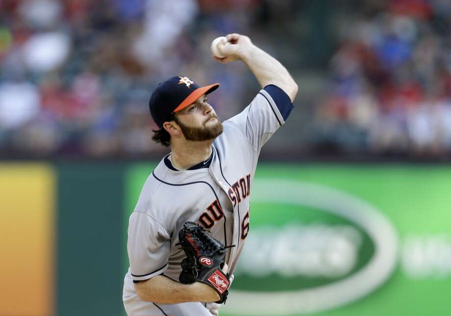 Astros starting pitcher Dallas Keuchel works against the Rangers.