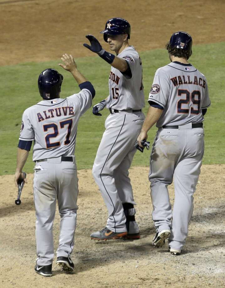 Jason Castro is congratulated by Jose Altuve and Brett Wallace following Castro's three-run home run.