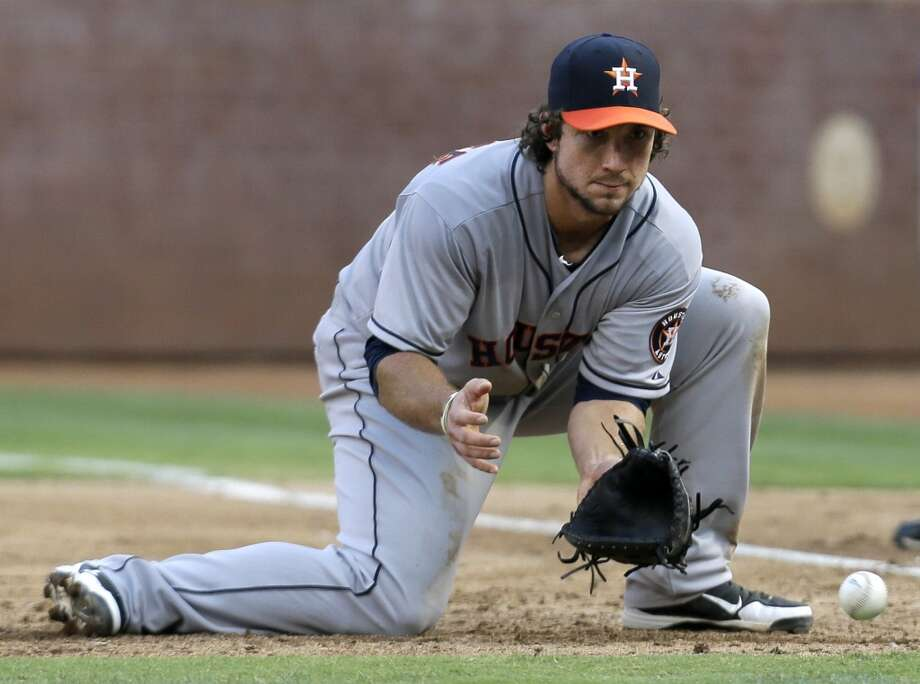 Astros first baseman Brett Wallace fields a grounder.