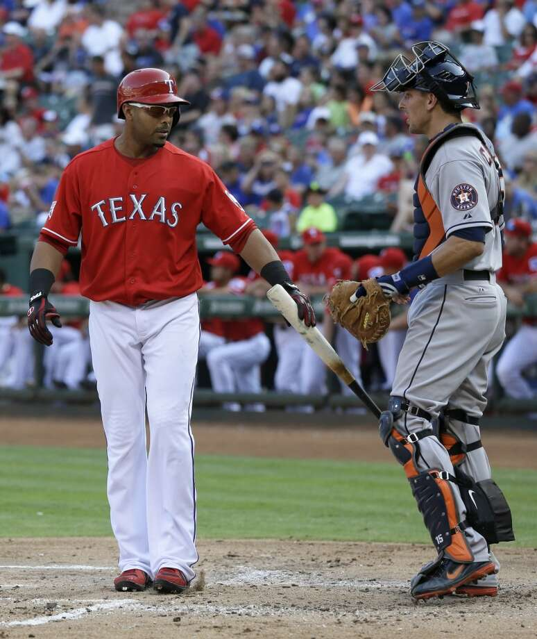Nelson Cruz gives a little tap to Astros catcher Jason Castro.