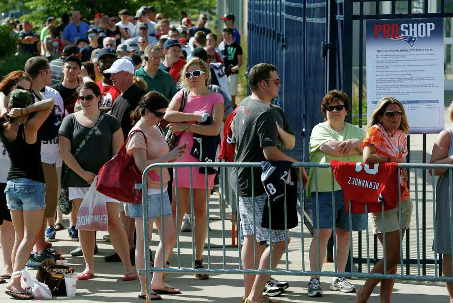 Fans wait to exchange their Patriots Aaron Hernandez jerseys at Gillette Stadium in Foxborough, Mass., on Saturday. The Pats offered a new jersey to all fans who wanted to get rid of the one they bought bearing Hernandez's name. Photo: Michael Dwyer, STF / AP