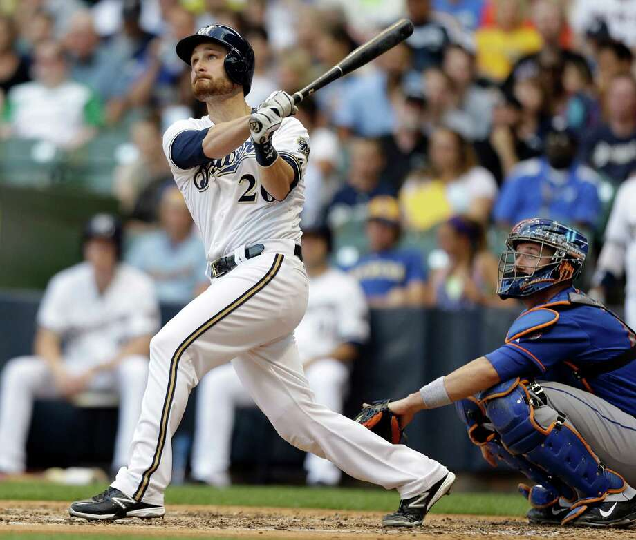 Milwaukee Brewers' Jonathan Lucroy, left, watches his home run against the New York Mets during the third inning of a baseball game on Saturday, July 6, 2013, in Milwaukee. (AP Photo/Jeffrey Phelps) ORG XMIT: WIJP105 Photo: Jeffrey Phelps / FR59249 AP
