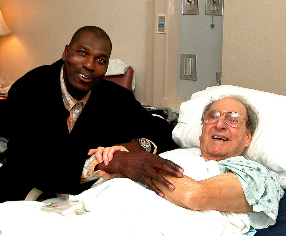 Hakeem Olajuwon and Guy V. Lewis. credit for both is Methodist Hospital. / handout email