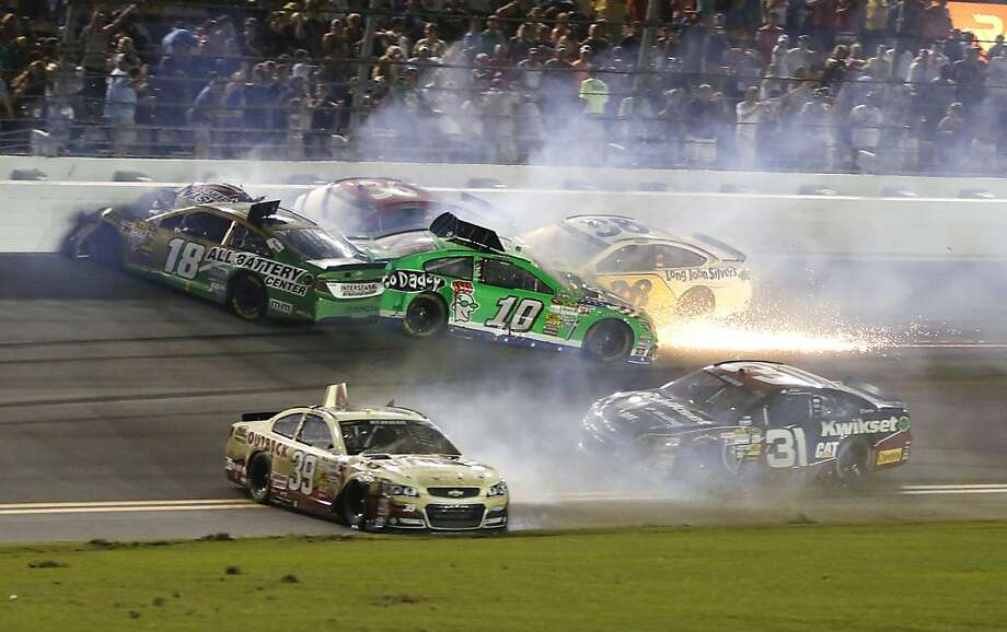 Kyle Busch (18), Danica Patrick (10), Ryan Newman (39), David Gilliland (38) and Jeff Burton (31) tangle in a last-lap wreck during the NASCAR Sprint Cup race at Daytona International Speedway. Photo: Reinhold Matay, Associated Press