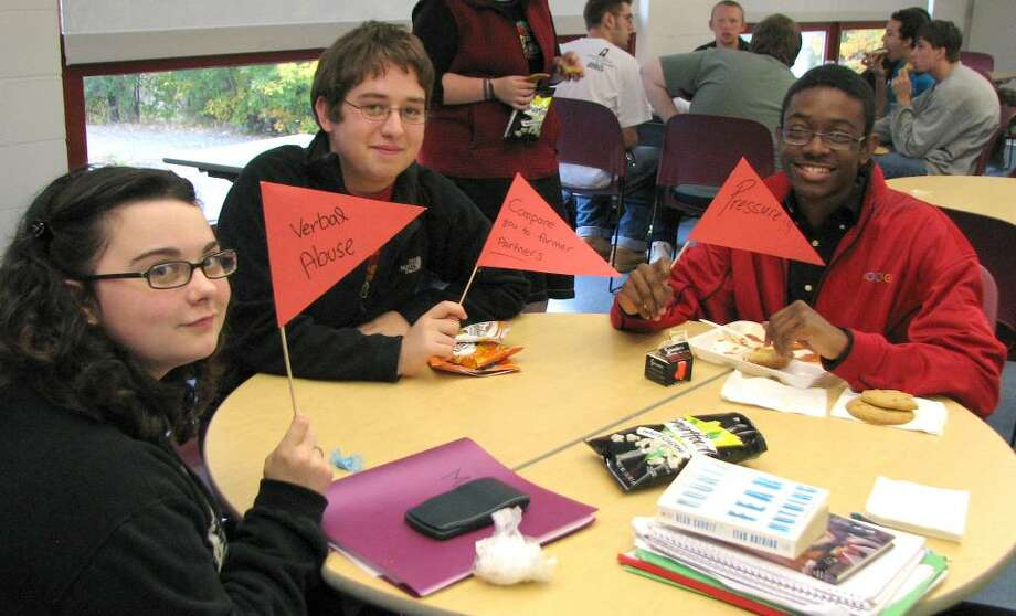 Participating in a Red Flag Campaign at Henry Abbott Tech in October, left to right,  Crystal Castonguay, Pedro DeAbreu, Jamel Carroll. Photo: Contributed Photo / The News-Times Contributed