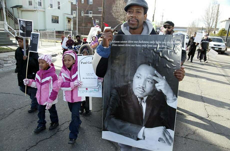 (R) Nate Vinson marches with his children (L-R) Darius, Nataya, and twin sister Natasia during the 25th Annual Bridgeport, Black Pride, Martin Luther King March on Stratford Avenue. Monday, Jan. 18, 2010 Photo: Phil Noel / Connecticut Post