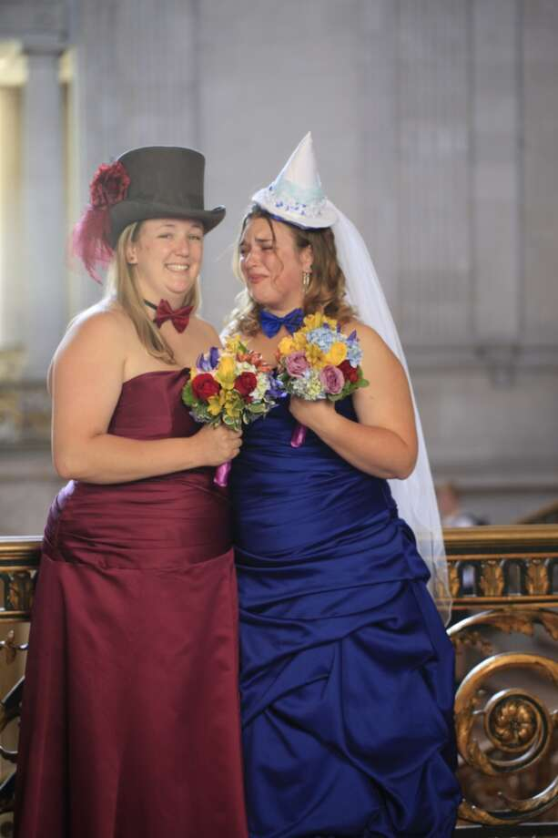 Anna and Melody Hennigh stand on the second floor of San Francisco City Hall moments after on Wednesday July 3, 2013.