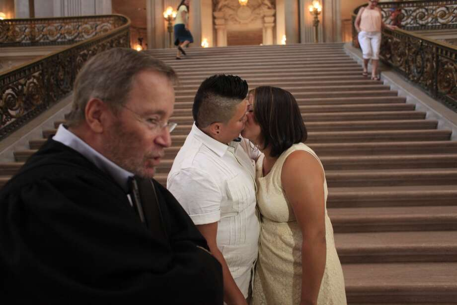 Seconds after being married by deputy marriage commissioner Allan Berenstein, Maria DelCarmen Robles and Ruth Nohemy Martinez kiss under the rotunda at San Francisco City Hall on Tuesday July 2, 2013.