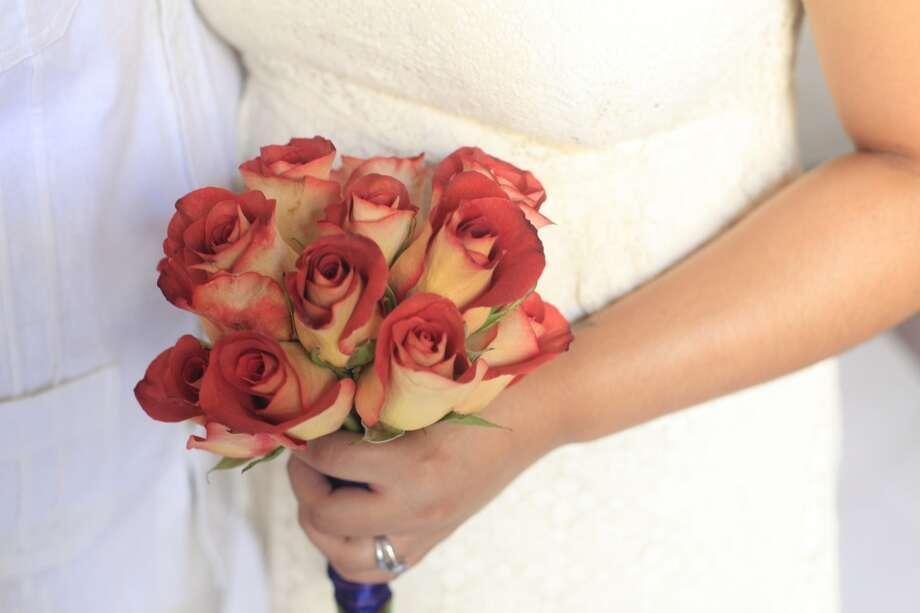 Before getting married at San Francisco City Hall, Ruth Nohemy Martinezon shows off her bouquet on Tuesday July 2, 2013.