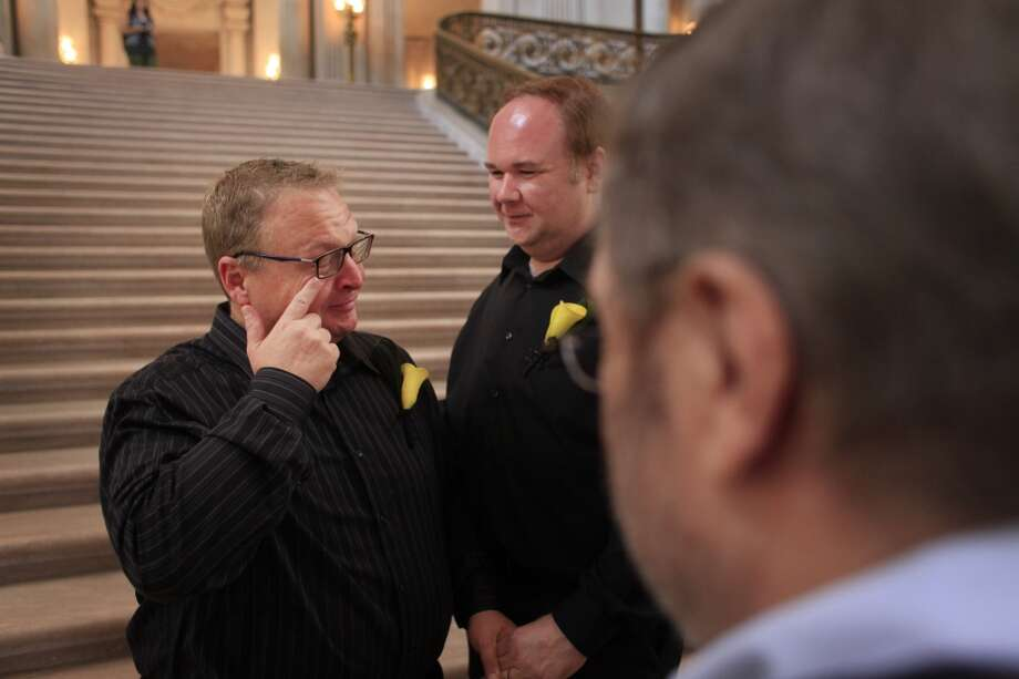 Larry Swabe wipes a tear moments after getting married to his long-time partner Graham Buffkin, 43, at San Francisco City Hall on Tuesday July 2, 2013.