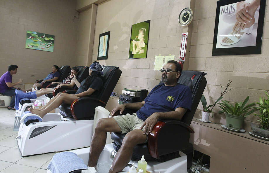 Karnes City motel manager Joe Morin waits for a pedicure at the Kenedy Beauty Salon Nails & Spa.