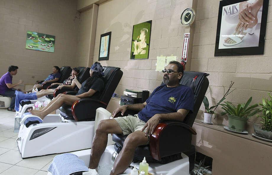 Karnes City motel manager Joe Morin waits for a pedicure at the Kenedy Beauty Salon Nails & Spa.