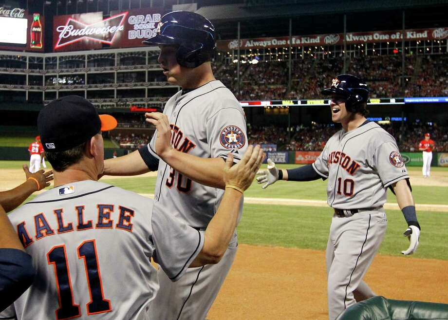 Jake Elmore,right, and the Astros showed a little more power against the Rangers, belting out three home runs including Elmore's eighth inning blast off Rangers reliever Tanner Scheppers. Photo: Tony Gutierrez, STF / AP