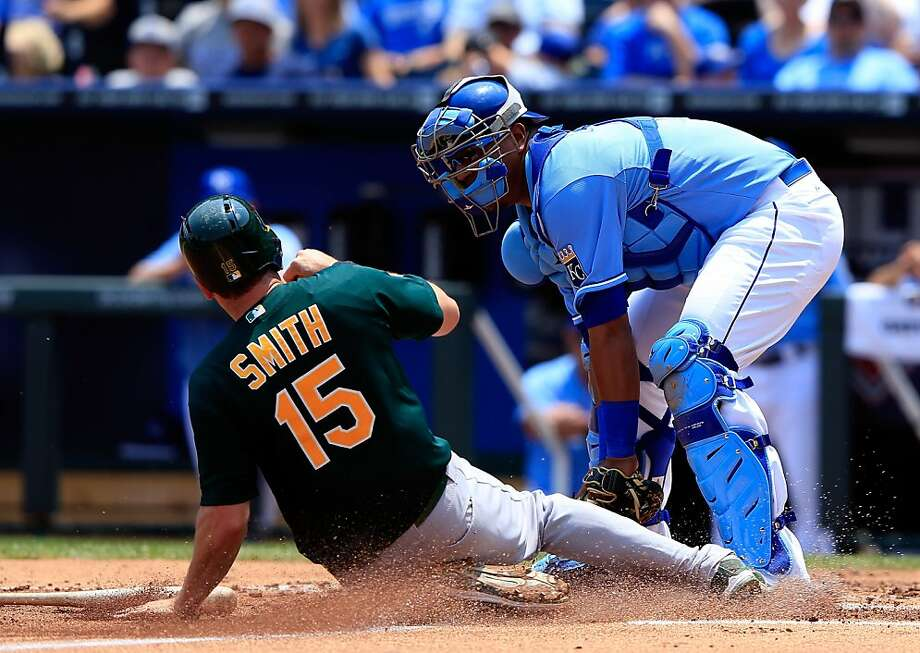 KANSAS CITY, MO - JULY 06:  Catcher Salvador Perez #13 of the Kansas City Royals tags out Seth Smith #15 of the Oakland Athletics at home plate while trying to score during the 2nd inning of the game at Kauffman Stadium on July 6, 2013 in Kansas City, Missouri.  (Photo by Jamie Squire/Getty Images) Photo: Jamie Squire, Getty Images