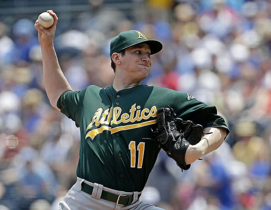 Oakland Athletics starting pitcher Jarrod Parker throws during the first inning of a baseball game against the Kansas City Royals on Saturday, July 6, 2013, in Kansas City, Mo. (AP Photo/Charlie Riedel) Photo: Charlie Riedel, Associated Press