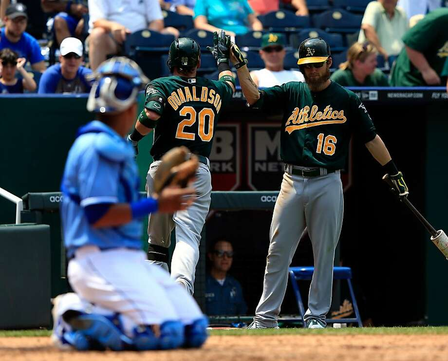 KANSAS CITY, MO - JULY 06:  Josh Donaldson #20 of the Oakland Athletics is congratulated by Josh Reddick #16 after hitting a solo home run during the 6th inning of the game at Kauffman Stadium on July 6, 2013 in Kansas City, Missouri.  (Photo by Jamie Squire/Getty Images) Photo: Jamie Squire, Getty Images