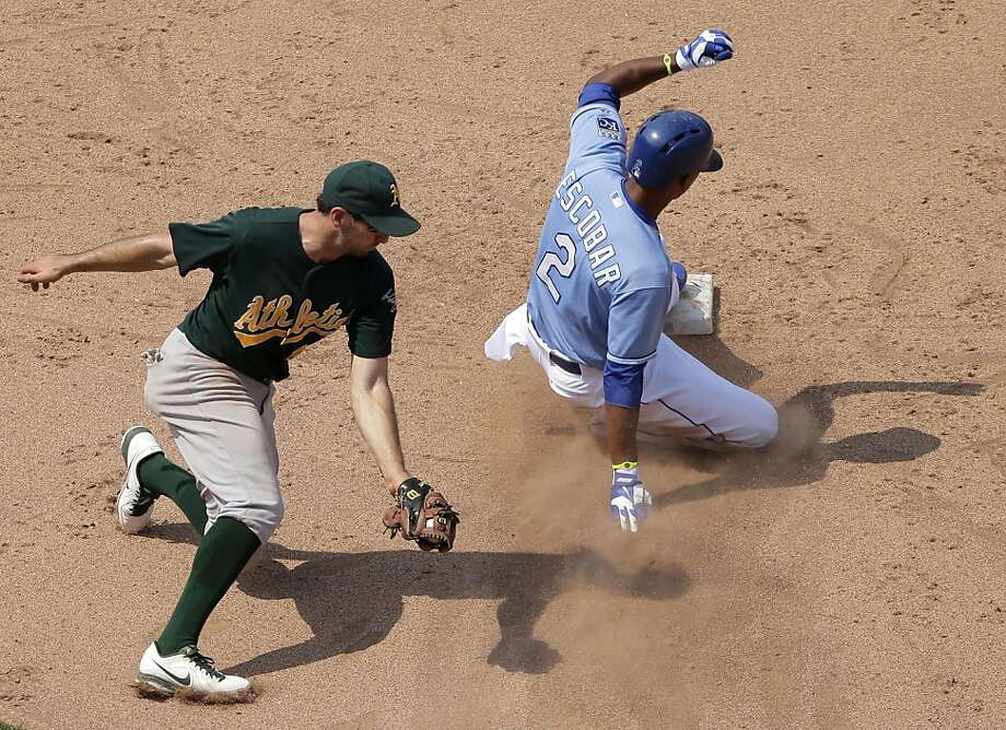 Kansas City Royals' Alcides Escobar gets past Oakland Athletics shortstop Adam Rosales to steal second during the eighth inning of a baseball game Saturday, July 6, 2013, in Kansas City, Mo. The Royals won 4-3. (AP Photo/Charlie Riedel) Photo: Charlie Riedel, Associated Press