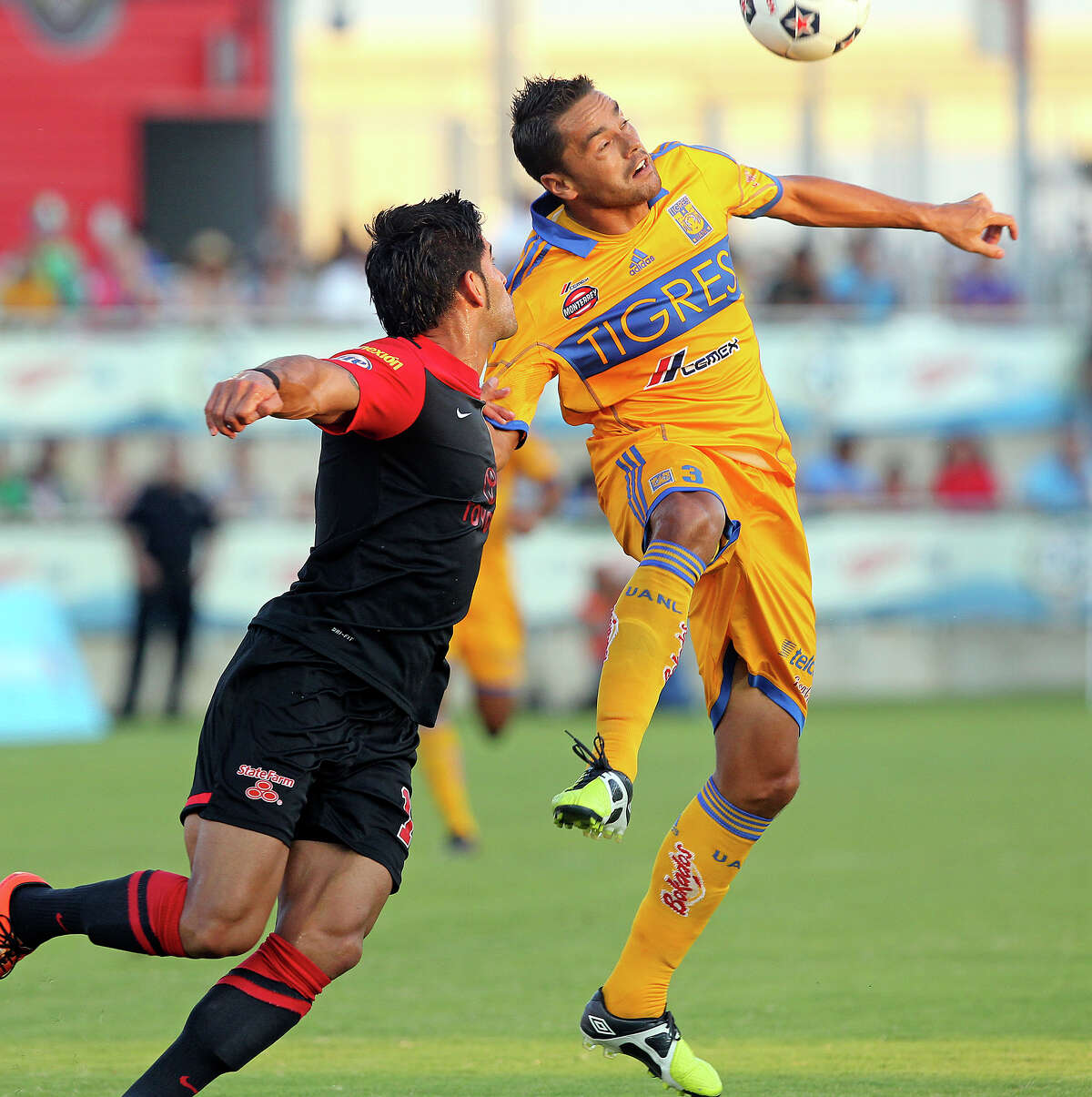 Esteban Bayona(left) defends against Anselmo Juninho as the Scorpions host the UNAL Tigres at Toyota Field on July 6, 2013.