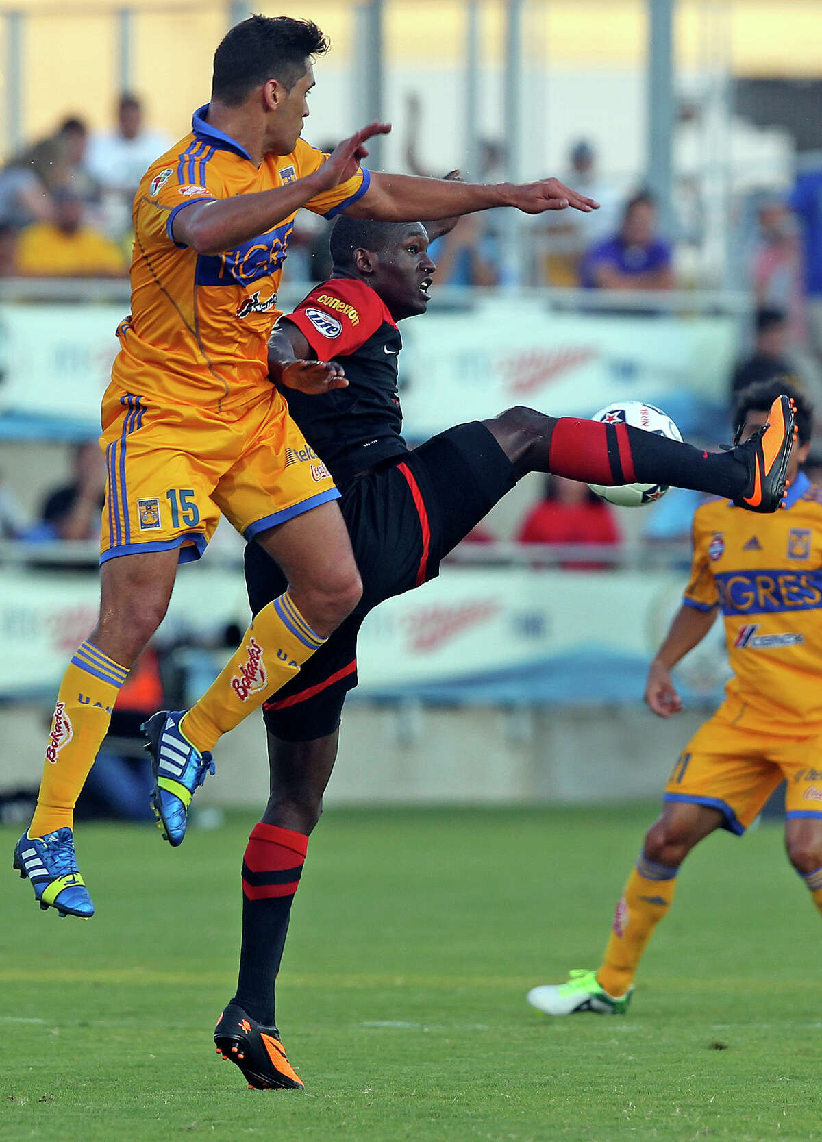 San Antonio's Fabrice Noel works the ball in the air against Manuel Viniegra as the Scorpions host the UNAL Tigres at Toyota Field on July 6, 2013.