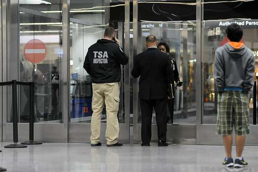 A TSA Inspector enters the security area where  victims and families  of the Asiana crash are being reunited, in the International Terminal at SFO in San Francisco, CA Tuesday July 6th, 2013. Photo: Michael Short, Special To The Chronicle