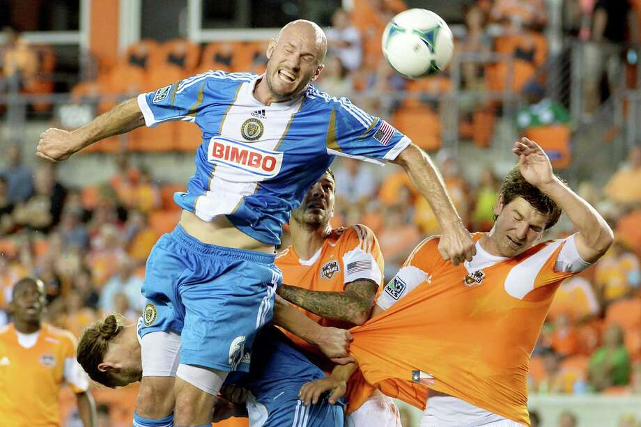 Philadelphia Union forward Conor Casey (6) goes up for a header over Houston Dynamo defender Bobby Boswell, right, during the first half of an MLS soccer match  on Saturday, July 6, 2013, at BBVA Compass Stadium in Houston. Photo: Smiley N. Pool, Houston Chronicle / © 2013  Houston Chronicle