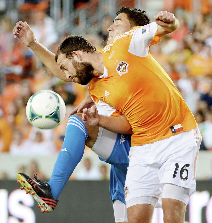 Houston Dynamo midfielder Adam Moffat (16) tries for a header against Philadelphia Union midfielder Leo Fernandes during the first half. Photo: Smiley N. Pool, Houston Chronicle / © 2013  Houston Chronicle