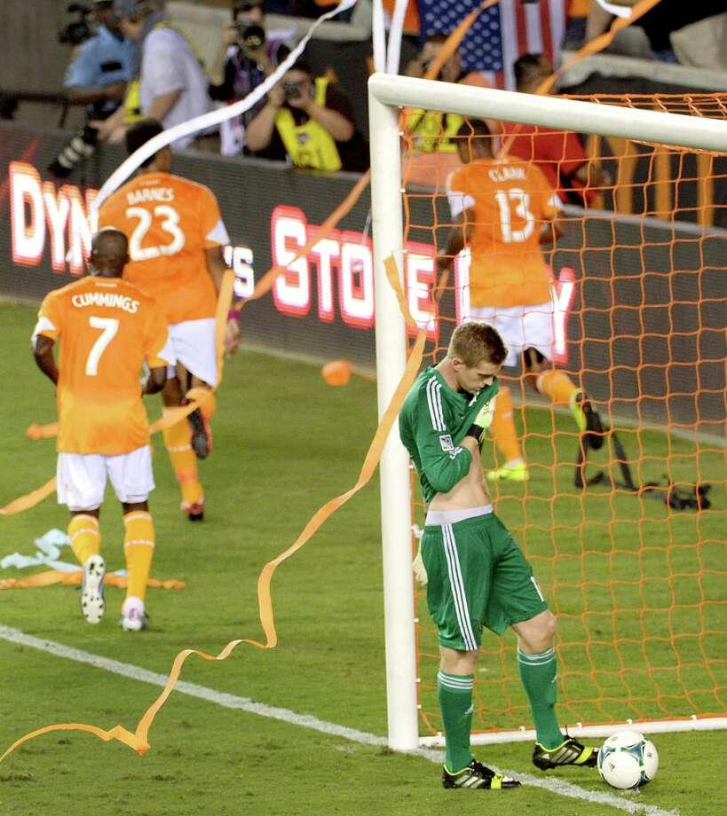 Philadelphia Union goalkeeper Zac MacMath kicks at the ball after a goal by Houston Dynamo midfielder Ricardo Clark (13) in the 59th minute. Photo: Smiley N. Pool, Houston Chronicle / © 2013  Houston Chronicle