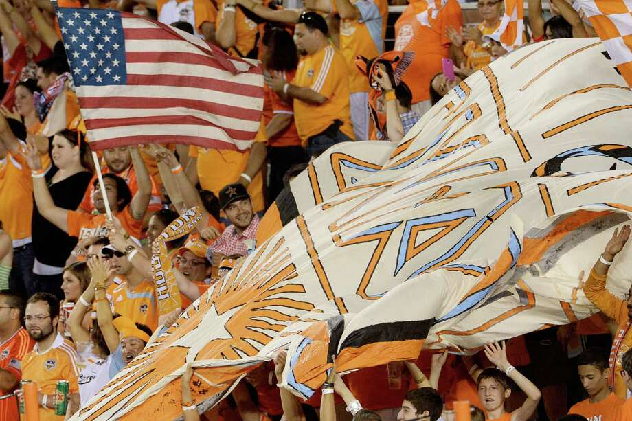 Houston Dynamo fans celebrate after a goal by  midfielder Ricardo Clark in the 59th minute. Photo: Smiley N. Pool, Houston Chronicle / © 2013  Houston Chronicle