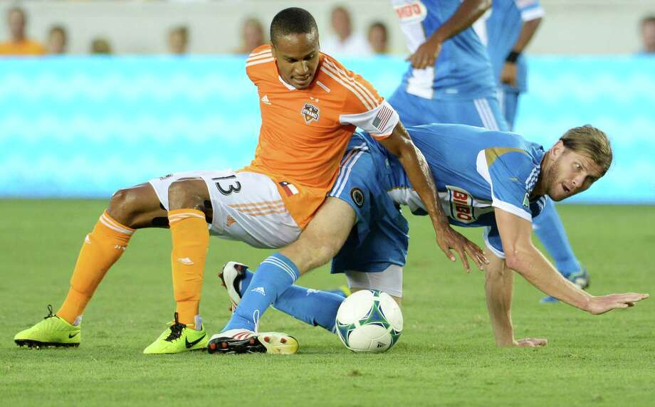 Houston Dynamo midfielder Ricardo Clark (13) takes down Philadelphia Union forward Aaron Wheeler. Photo: Smiley N. Pool, Houston Chronicle / © 2013  Houston Chronicle