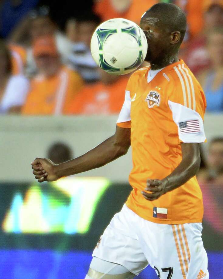 Dynamo midfielder Boniek Garcia takes a ball to the face during the first half. Photo: Smiley N. Pool, Houston Chronicle / © 2013  Houston Chronicle