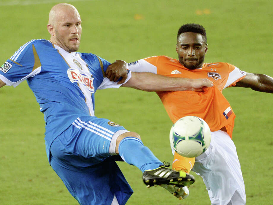 Philadelphia Union forward Conor Casey, left, fights for the ball against Houston Dynamo defender Warren Creavalle. Photo: Smiley N. Pool, Houston Chronicle / © 2013  Houston Chronicle