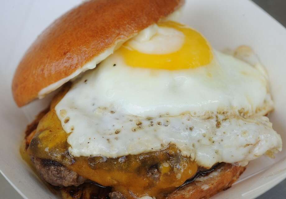 The Sydny Burger at Burger Guys consists of a fried egg, cheddar, aioli and grilled pineapple. Photo taken Thursday, June 20, 2013 Guiseppe Barranco/The Enterprise