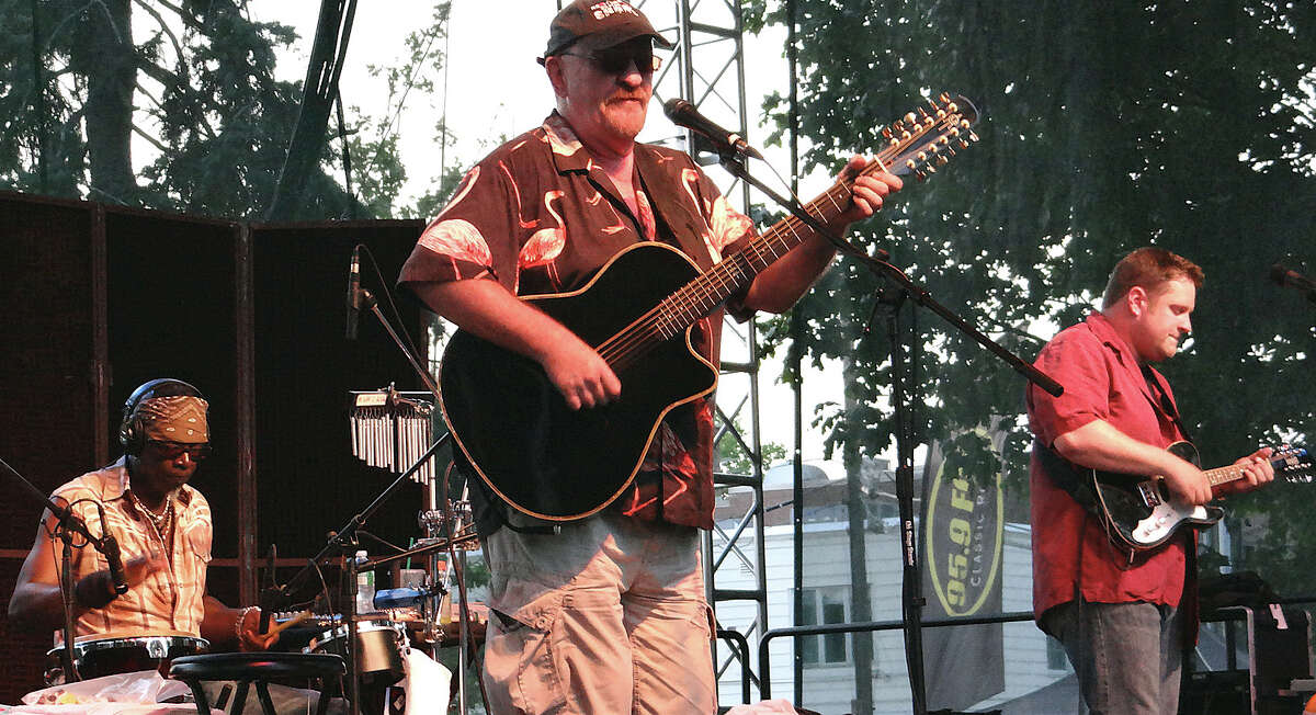 Dave Mason and his acoustic group performed Saturday evening on Jesup Green. WESTPORT NEWS, CT 7/6/13