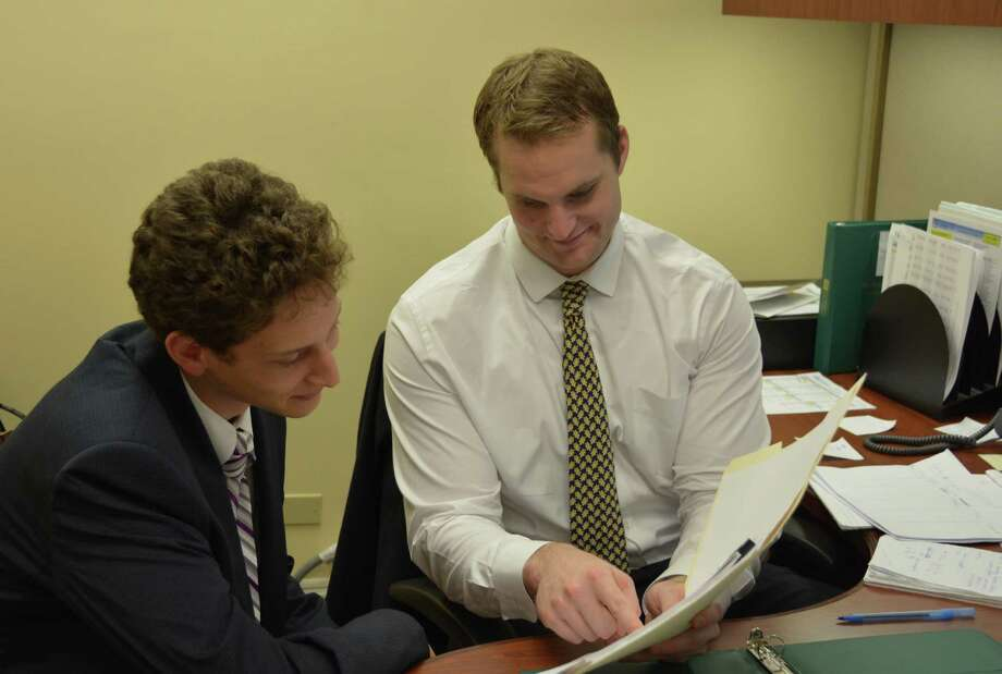Matt Parrino, left, works with Rob Kunces, a marketing associate and financial analyst at The Bank of New Canaan. Photo: Contributed