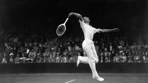 29th June 1936:  British tennis player, Fred Perry in action against BH Grant in court number one at Wimbledon.
